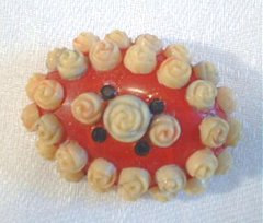 Antique Celluloid Rosette Brooch
